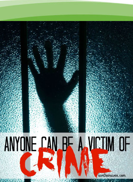Scary image of a hand on a window with a saying that anyone can be a victim of crime.