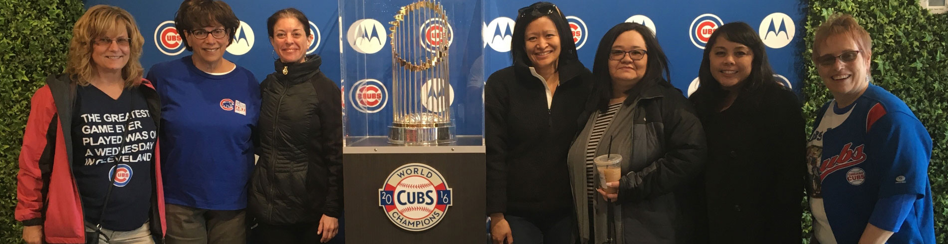 It's important to have the proper ear plugs when attending loud events. This group of women are attending an event for the Chicago Cubs.